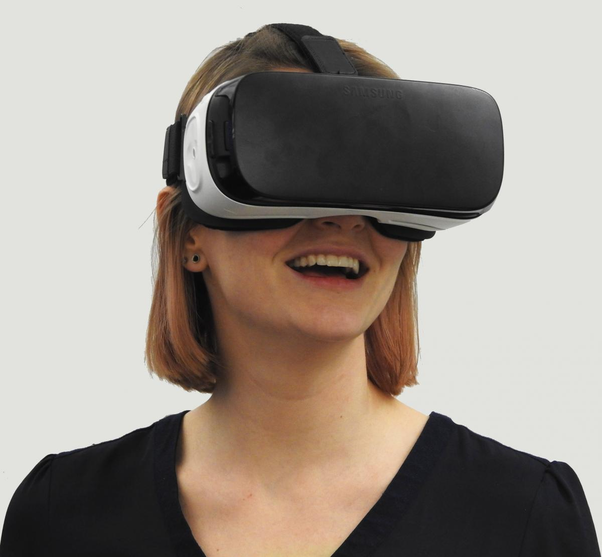 wearing virtual reality headset being worn by a woman