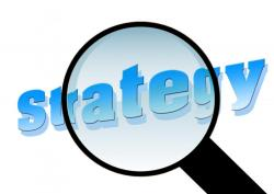 Magnifying glass over the word Strategy
